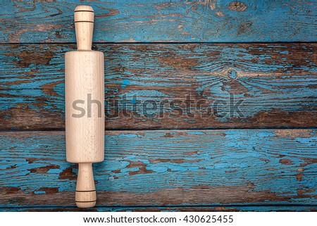 Rolling pin. Kitchenware on wooden background. Accessories for cooking. - stock photo