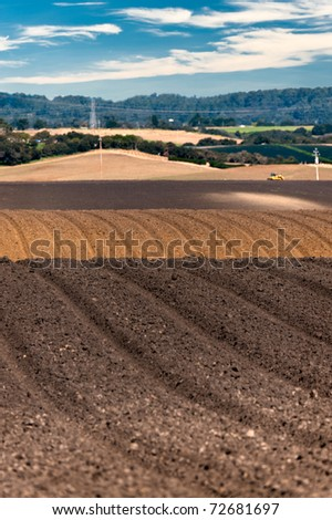 Rolling plowed fields in the Salinas Valley of California - stock photo
