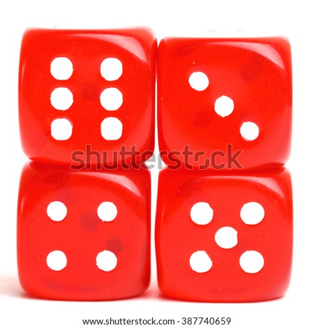 rolling red dice isolated on white. studio shot