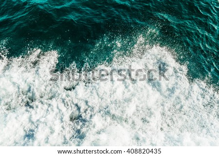 Rolling sea waves, top view of ocean covered by foam, turquoise and green color water - stock photo