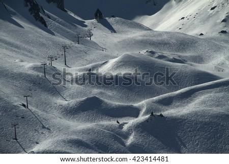 Rolling snow covered ski hills at the Klewenalp ski resort in Switzerland - stock photo