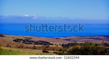 Rolling South Australian farmland, with Kangaroo Island in the distance. - stock photo