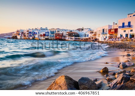 Rolling waves and sunset dining at famous Mykonos neighborhood of Little Venice, Mykonos, Greece - stock photo