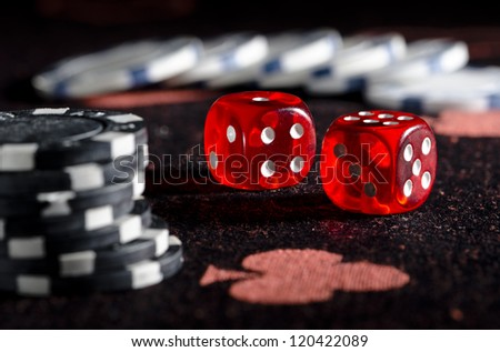 Rolling winning dice at casino - stock photo