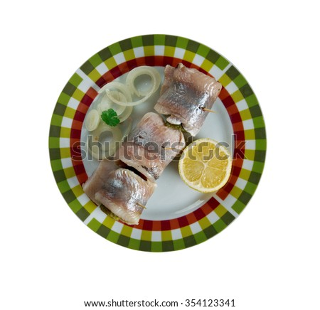 Rollmops -  pickled herring fillets, rolled slices of onion, pickled gherkin. - stock photo