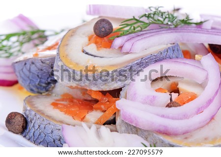 Rolls from a herring on a plate - stock photo