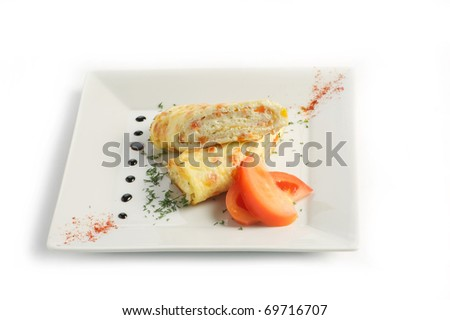 Rolls from an omelette with cheese tomatoes on a light plate on a white background - stock photo