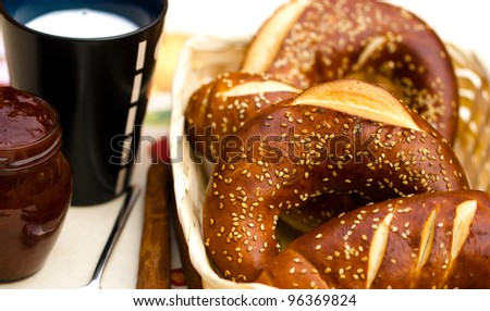 Rolls, jam and cup of milk - stock photo