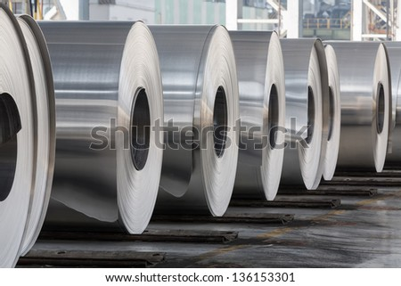 Rolls of aluminum close up in production shop of plant. - stock photo