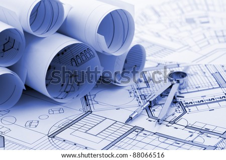 rolls of architectural house plans & compass - stock photo