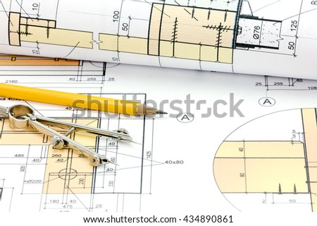 rolls of blueprints with architectural plans and technical drawings closeup - stock photo
