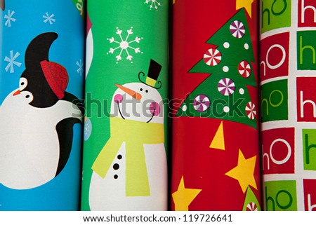 Rolls of Christmas Wrapping Paper - stock photo