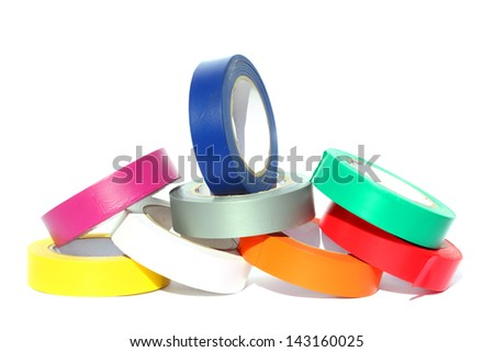 Rolls of color insulation adhesive tape isolated on a white background - stock photo