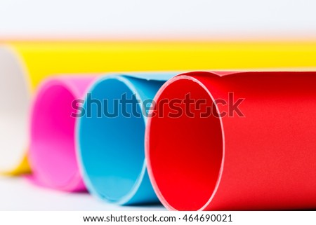 Rolls of color paper on white background