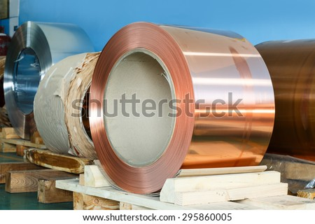 Rolls of copper foil waiting for assembly - stock photo