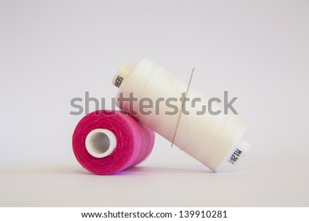 rolls of cotton on white - stock photo