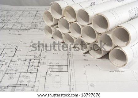 Rolls of engineering (or architectural) drawings (blueprints) - stock photo