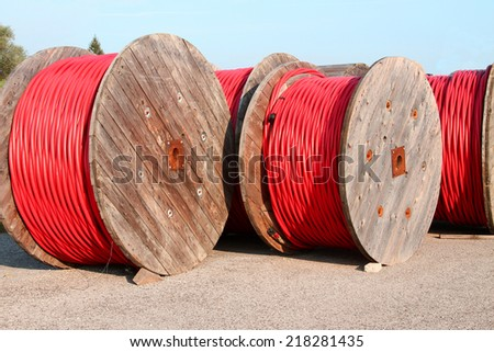 rolls of high-voltage power cable in the power station - stock photo