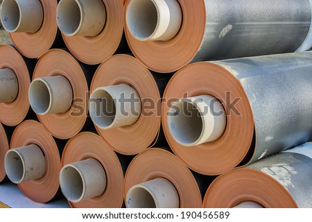 Rolls of insulation material at the construction site. Waterproofing membrane system. - stock photo