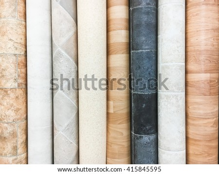Rolls of lino in a homeware store - stock photo