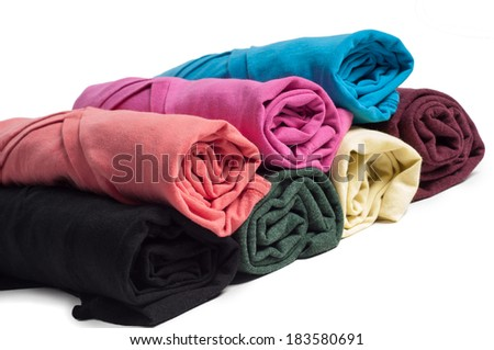 Rolls of multicolored clothes - stock photo