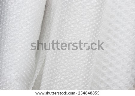 Rolls of new bubblewrap as a background - stock photo
