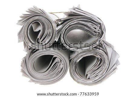 Rolls of Newspapers on White Background - stock photo