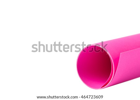 Rolls of pink color paper on white background