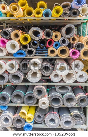 Rolls of plastic for building materials.