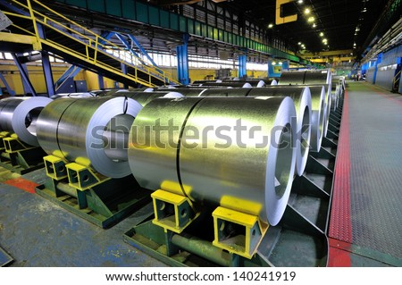 rolls of steel sheet inside of plant, galvanized steel coil - stock photo