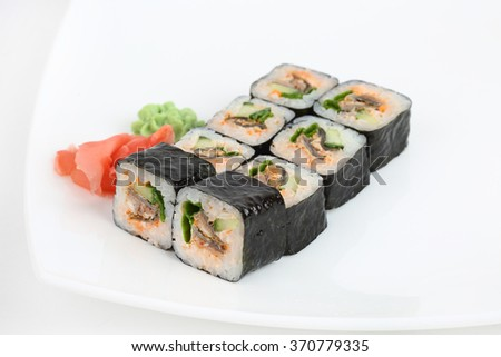 Rolls of sushi isolated on white background on a plate