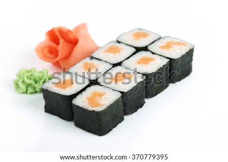 Rolls of sushi isolated on white background on a plate - stock photo