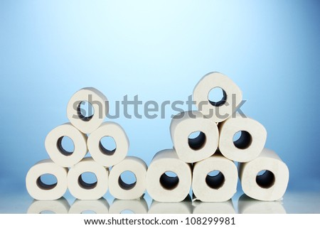 rolls of toilet paper on blue background