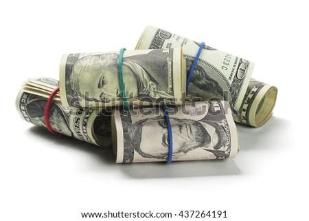 Rolls of US Dollars Lying on White Background - stock photo
