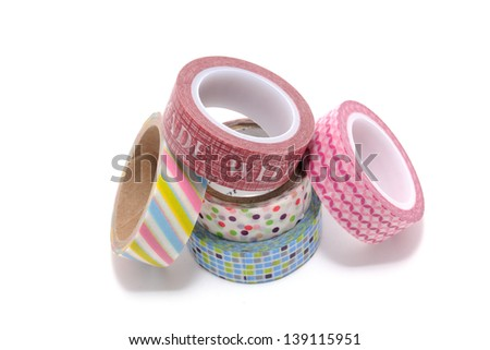 Rolls of Washi Tape isolated on white background. Is a decorative handmade paper with a traditional Chinese method that was introduced in Japan by a Korean Buddhist priest. - stock photo