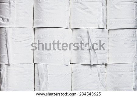 Rolls of white toilet paper as a background - stock photo