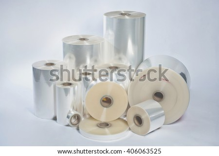 Rolls of wrapping plastic stretch film on white background - stock photo