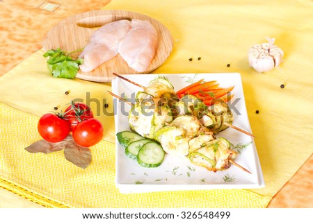 Rolls of zucchini and chicken fillets - stock photo