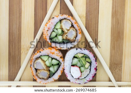 rolls with chopsticks on a cutting board - stock photo