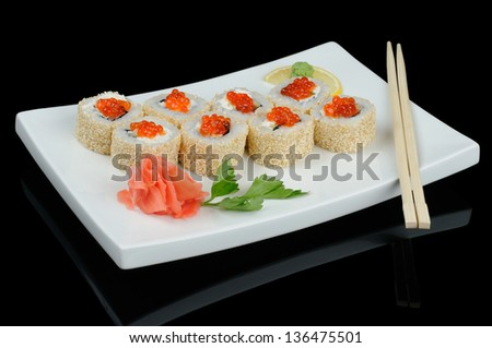 Rolls with red caviar and sesame served on white plate