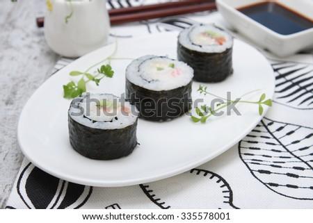 rolls with smoked salmon - stock photo