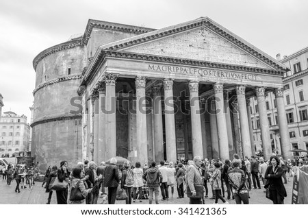 Roma, Italy - October 2015: Foreign tourists stroll and take pictures of the ancient Rome of Italy near the historic site of the Pantheon autumn day - stock photo