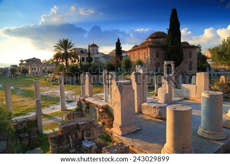 Roman Agora with ancient columns and Byzantine church at sunset, Athens, Greece - stock photo