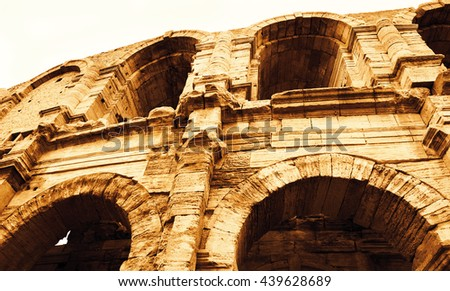 Roman amphitheatre in Arles (Bouches-du-Rhone, Provence-Alpes-Cote d'Azur, France). Toned photo. - stock photo