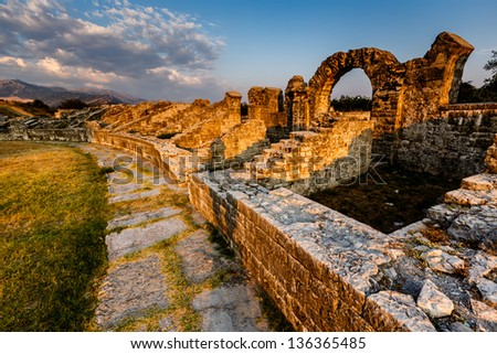 Roman Ampitheater Ruins in the Ancient Town of Salona near Split, Croatia - stock photo