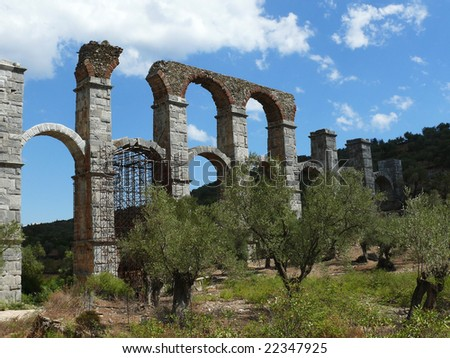 Roman aqueduct between olive trees. Moria - Lesbos island - Greece