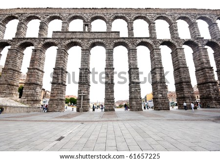Roman aqueduct bridge of Segovia  Spain was built around the 1st century AD, during the time of the Emperor Trajan, Claudius or Nerva, it takes water 17km from the Fuente Fria river.  No mortar used. - stock photo