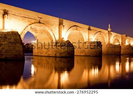 Roman Bridge and Guadalquivir river, Cordoba, Spain - stock photo