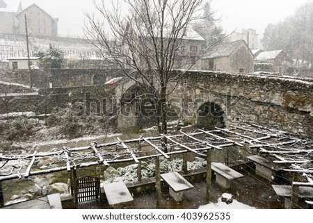 Roman bridge at Giornico onder snow on Leventina valley, Switzerland