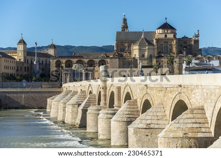 Roman bridge, built in the early 1st century BC across the Guadalquivir river in the Historic centre of Cordoba, Andalusia, southern Spain. - stock photo